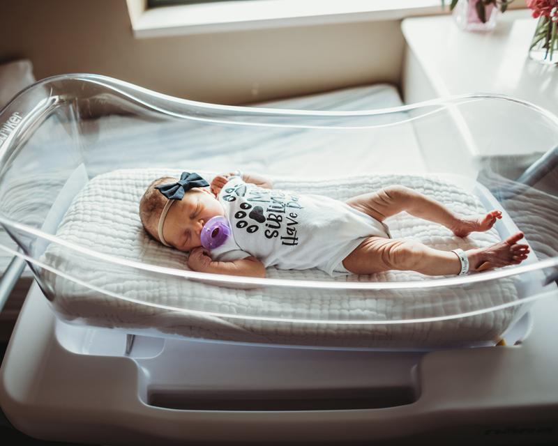 Atlanta Newborn Photographer, newborn baby lay sleeping in hospital bassinet with pacifier