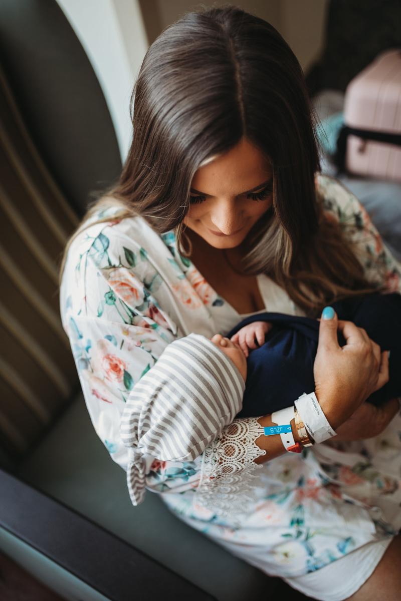 Atlanta Newborn Photographer, mother gazes at her newborn baby in her arms