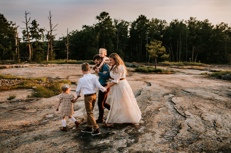 Atlanta Family Photographer, Family of five all smiling hike near a forest