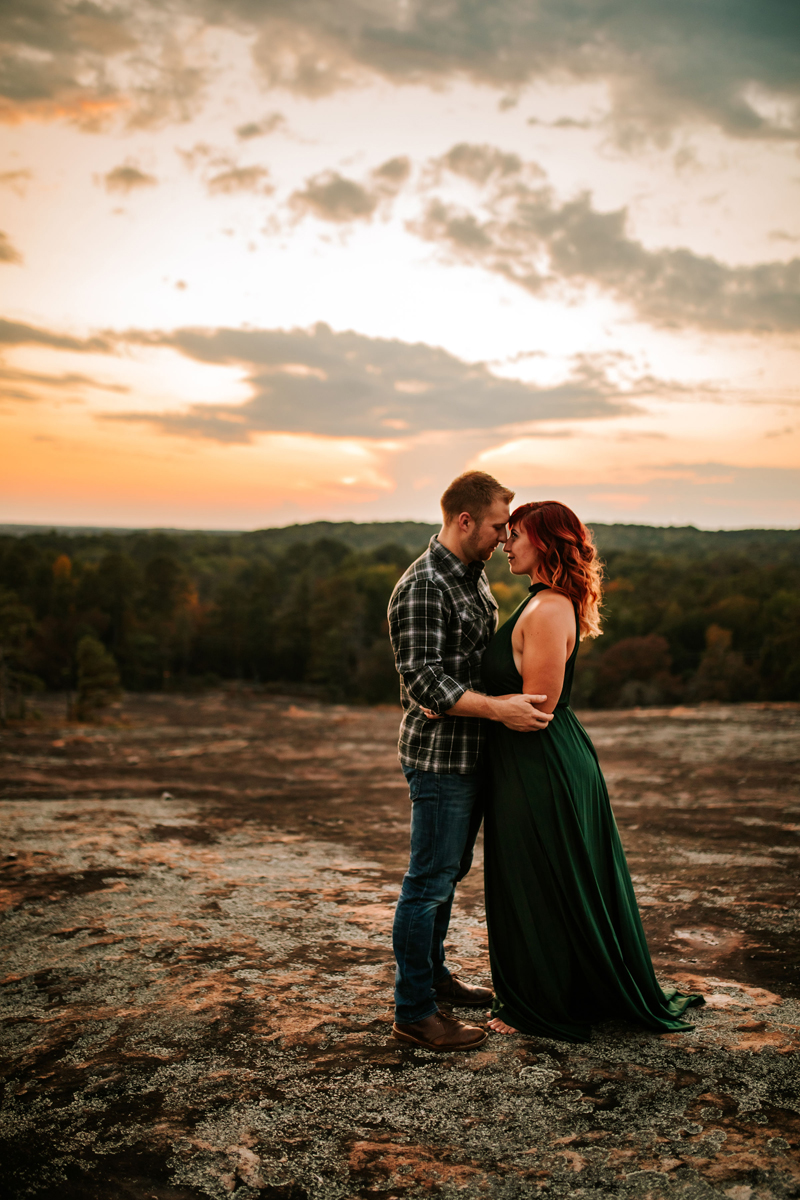 Atlanta Couples Photographer, a man and woman are embracing lovingly nose to nose at sunset