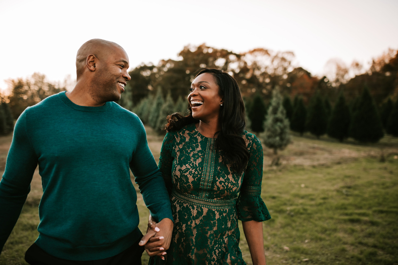 Atlanta Couples Photographer, before a forest, a man and woman gaze into each other eyes with big smiles