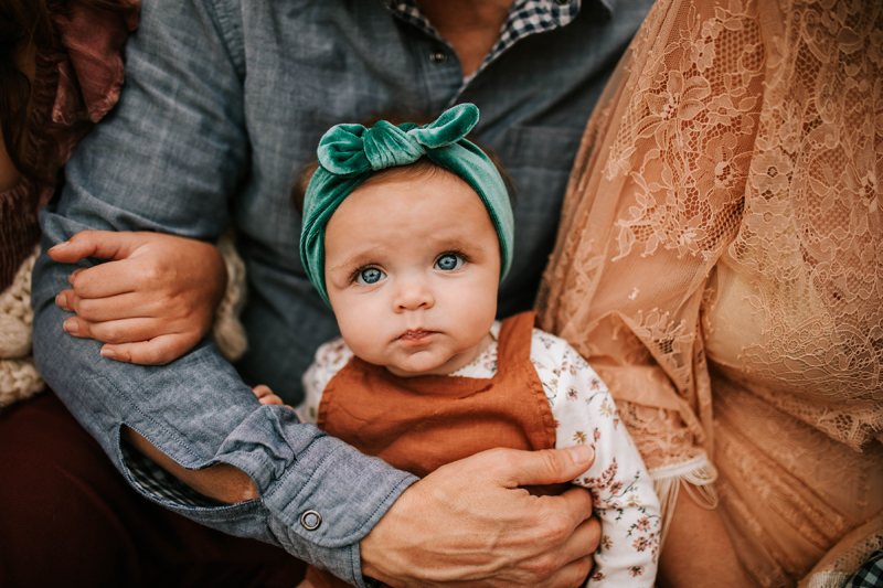 Atlanta Family Photographer, Blue-eyed baby is held tightly in family's arms