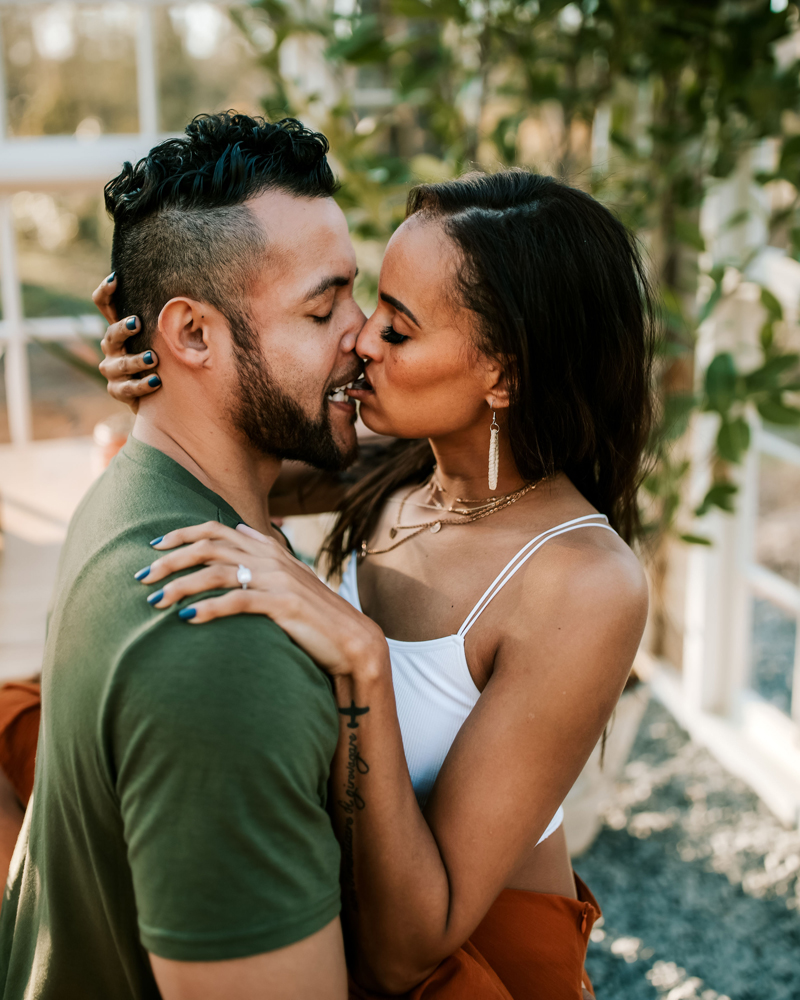 Atlanta Couples Photographer, a couple share a steamy kiss, the man bites the woman's lip