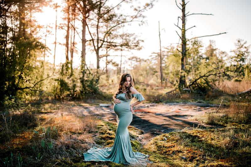Atlanta Maternity Photographer, full term Pregnant is in beautiful flowing dress out in nature