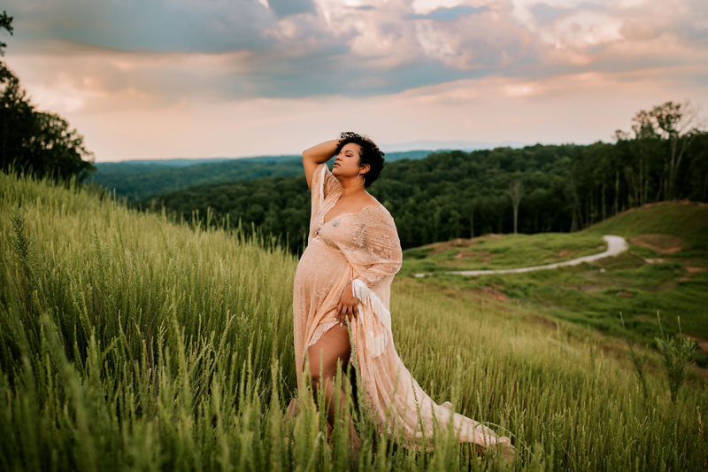 Atlanta Maternity Photographer, Pregnant mother stands on grassy hillside in lacy dress