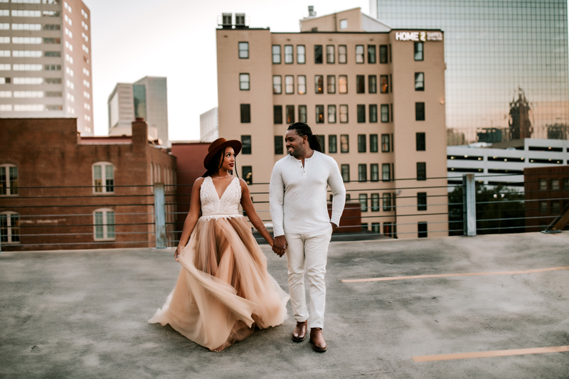 Atlanta Family Photographer, Man and Woman dressed in white walk in a cityscape