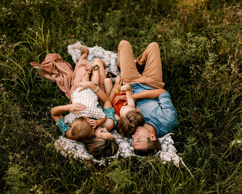 Photography Workshops, Family of four laying in the grass together
