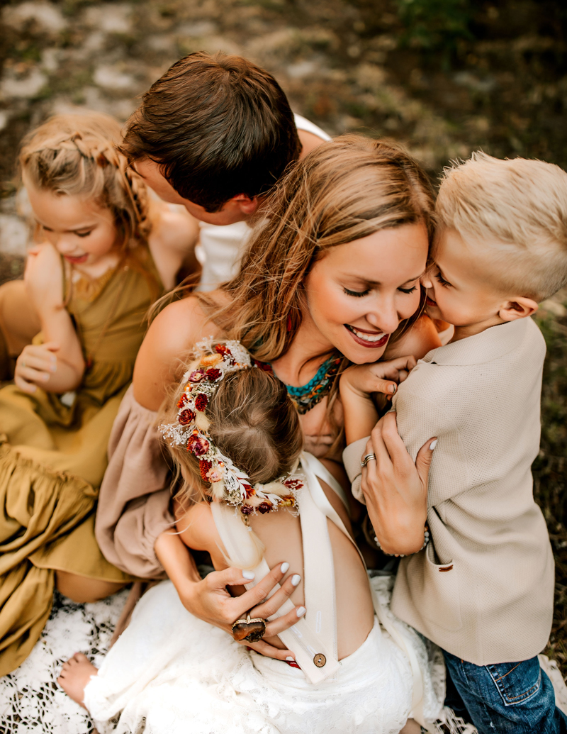 Atlanta Family Photographer, a man and a woman embrace their children smiling, two girls and a young boy